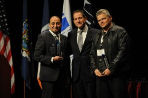 Carlos Guevara and George Rosa accept the Excellence in Technology Award