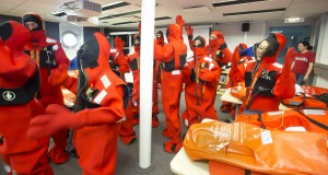 Scientists in orange rubber immersion suits