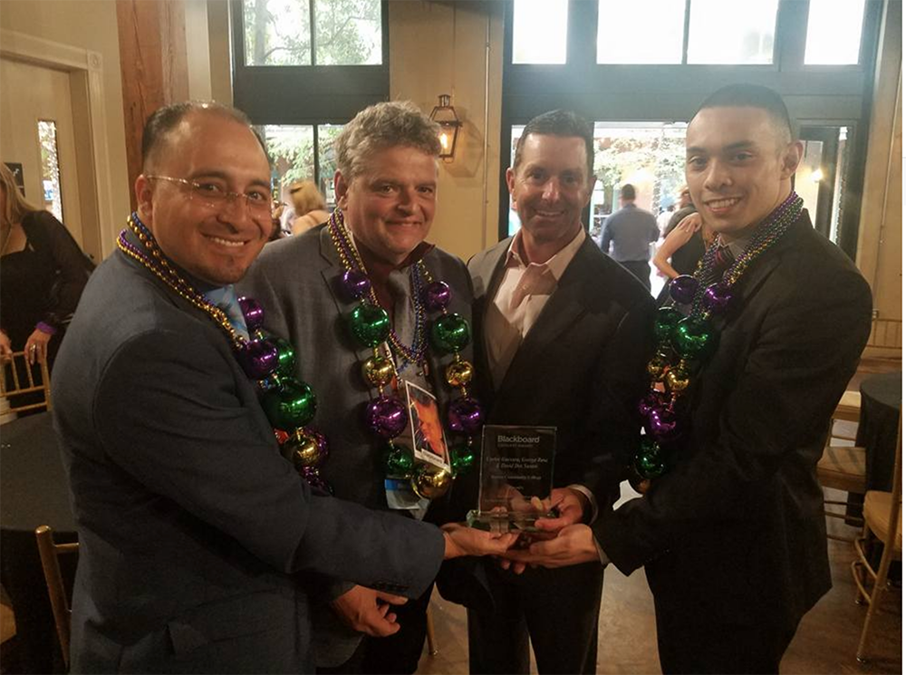 Carlos Guevara, George Rosa and David Dos Santos accept the Blackboard Catalyst Award