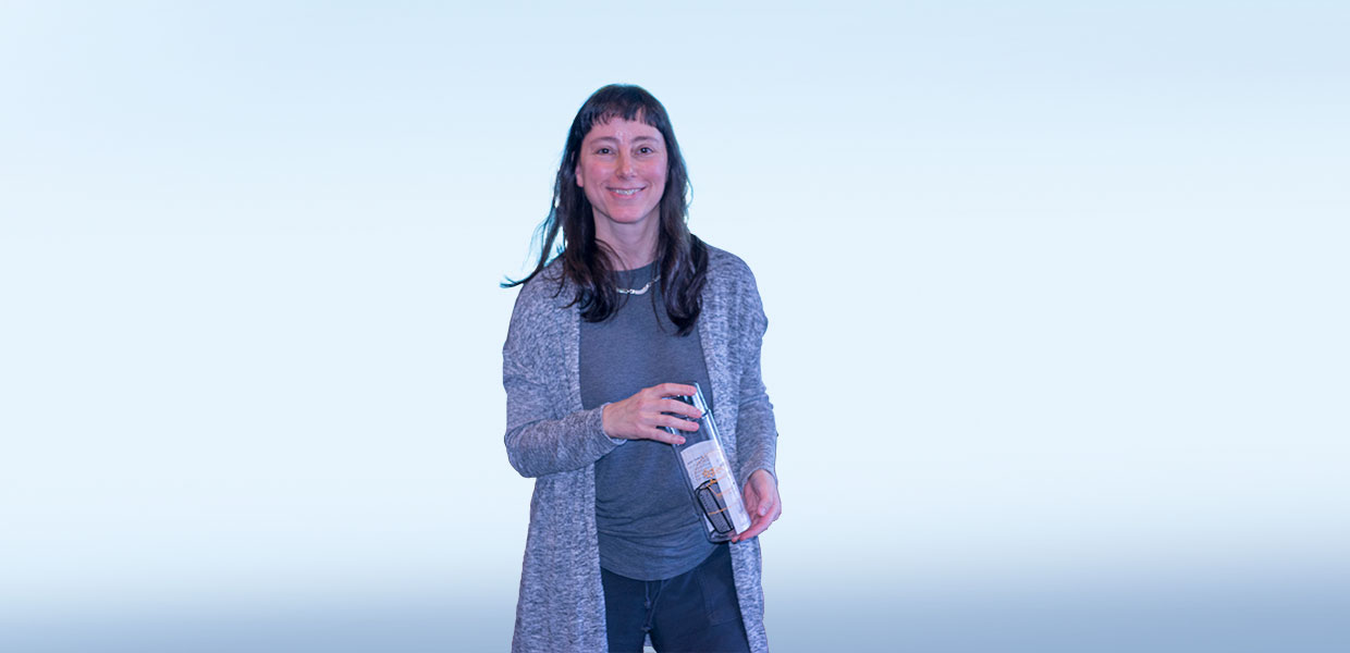 Prof. Laura Andel holding her water bottle award